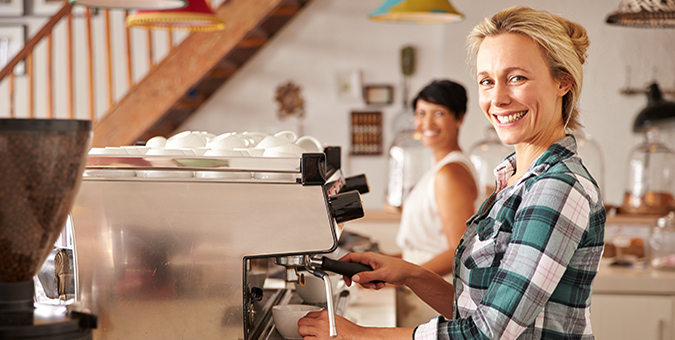 women working in coffee shop small business